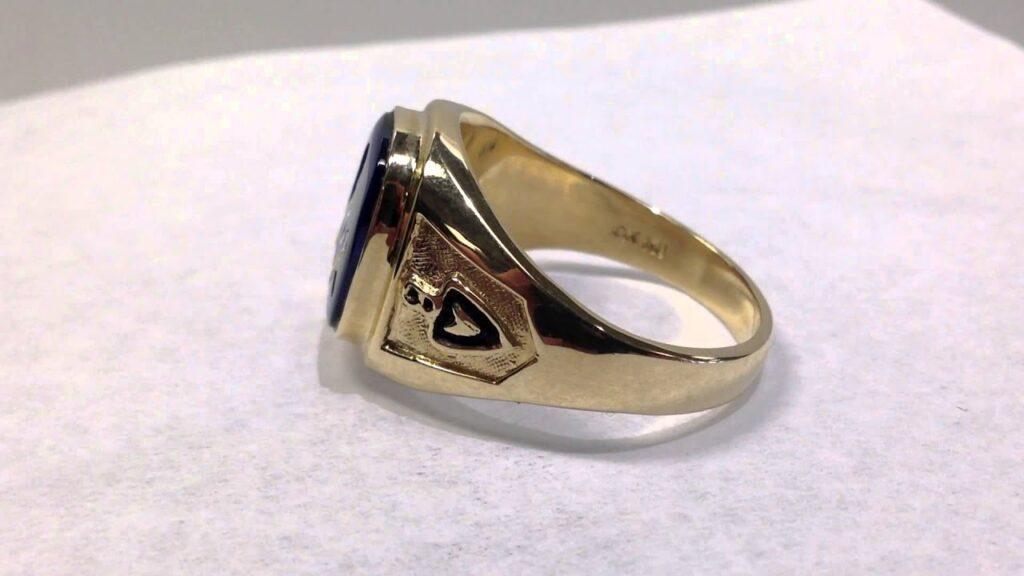 Gr460 10k yellow gold closed back blue stone Masonic ring at BrocksJewelers.com